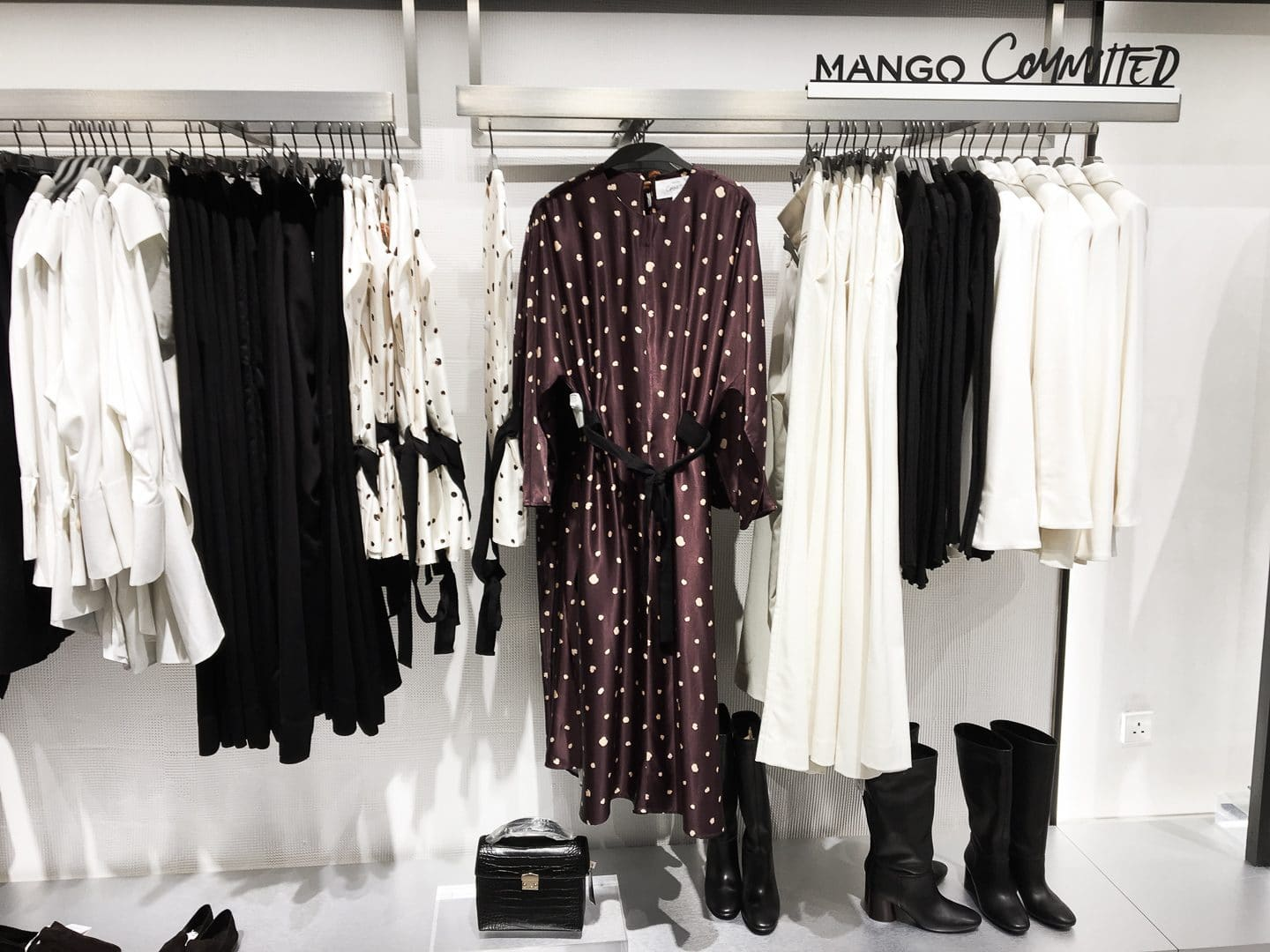 Mango's Committed range of clothing hung on a rail