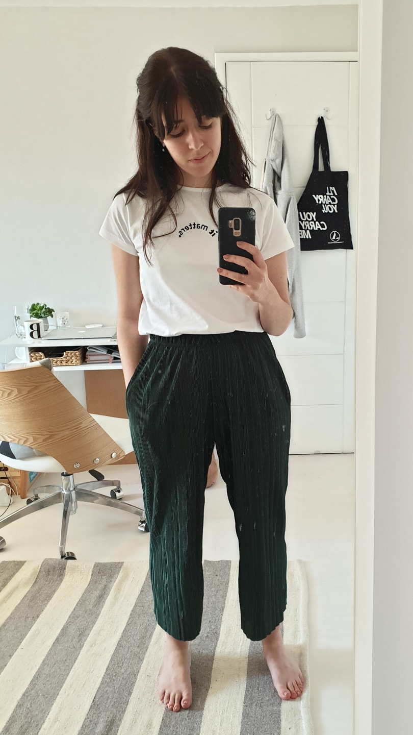 Besma in white It Matters t-shirt with green wide-leg trousers