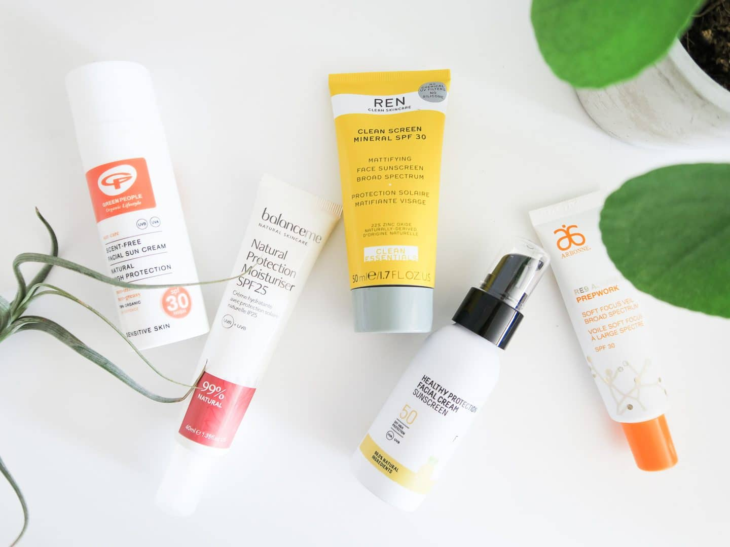 Five different facial sunscreen moisturisers laid side-by-side