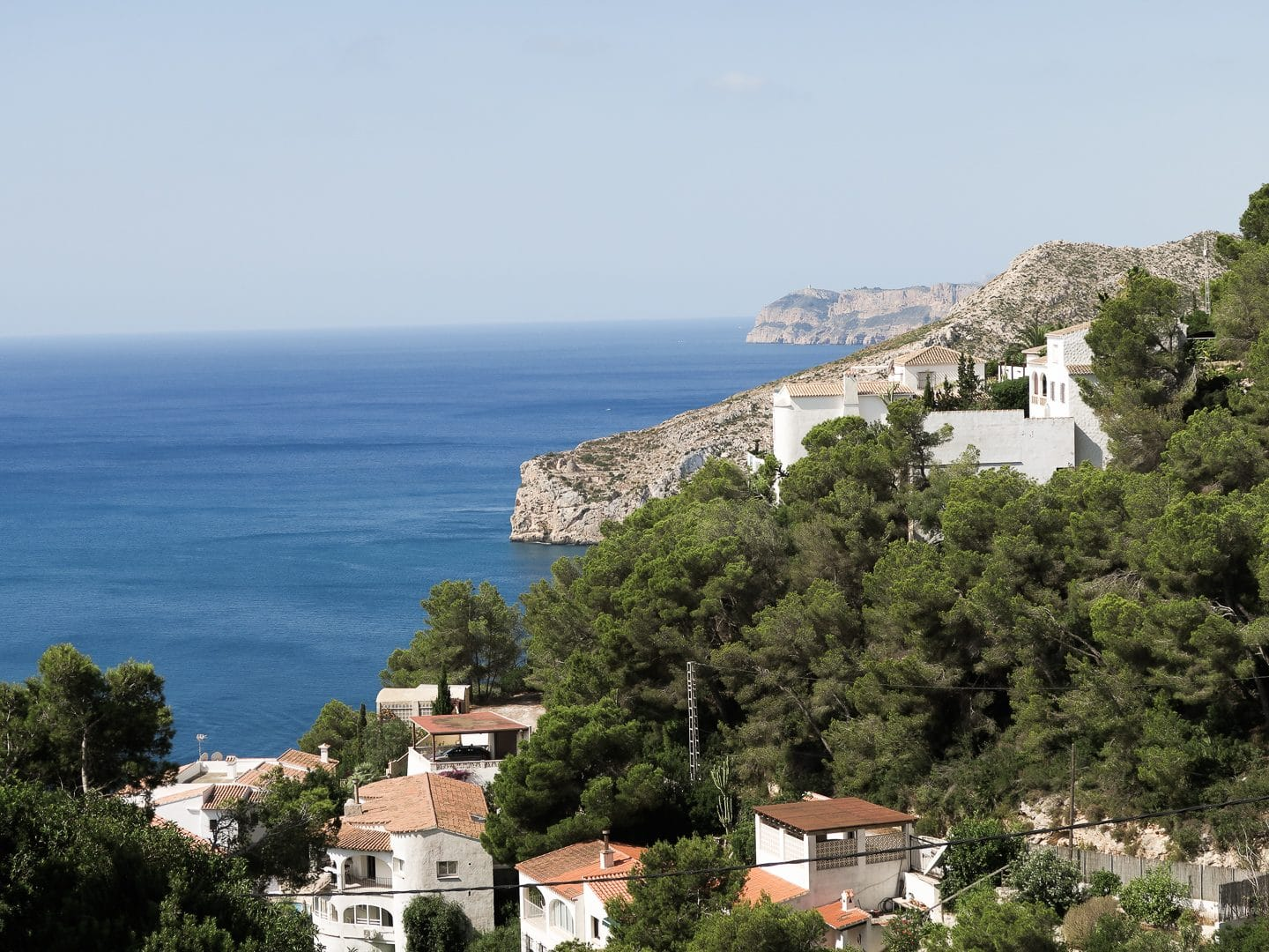 Sea bay overlooked by villas on a mountain