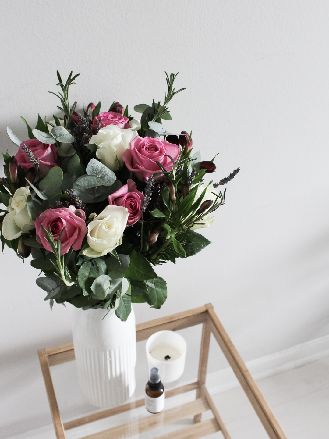 Bouquet of flowers on a small wooden table