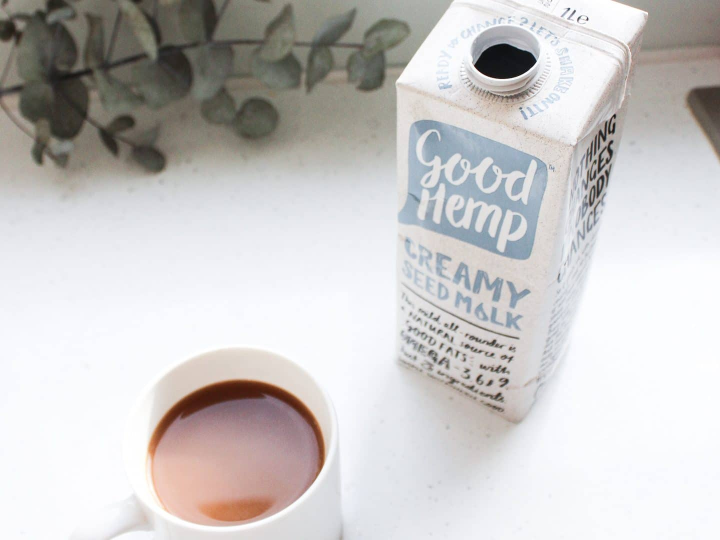 Good Hemp's hemp milk next to coffee