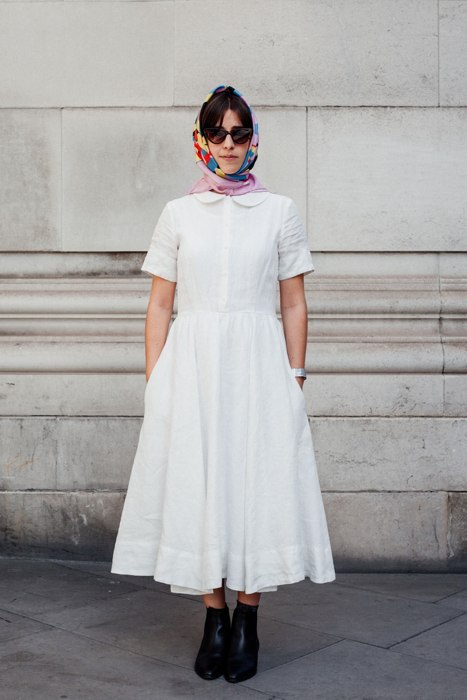 Besma wearing white dress with pink headscarf and sunglasses