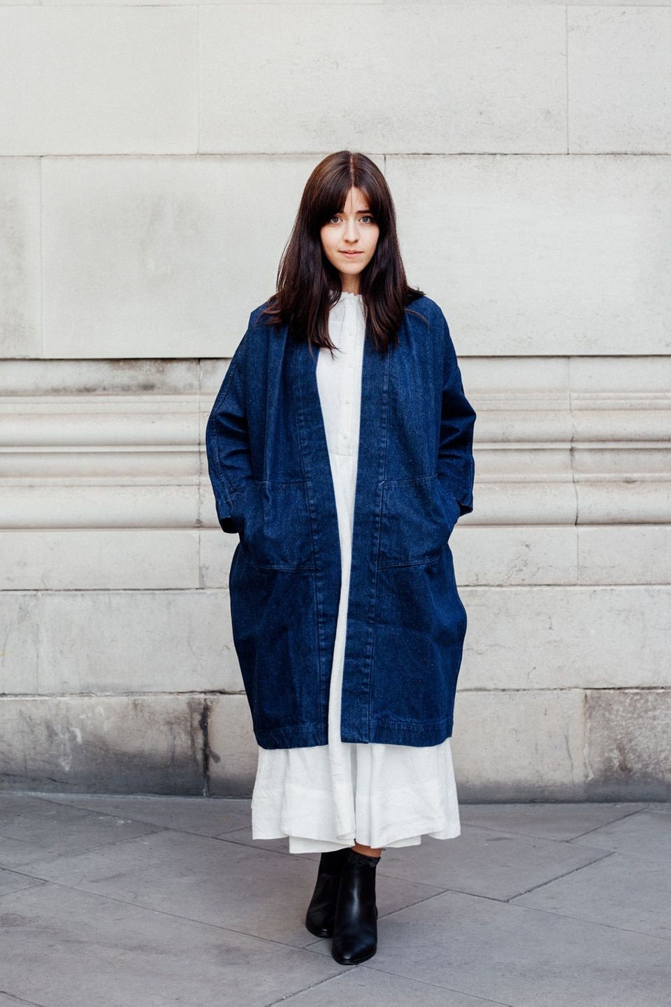 Besma wears white dress with longline denim jacket