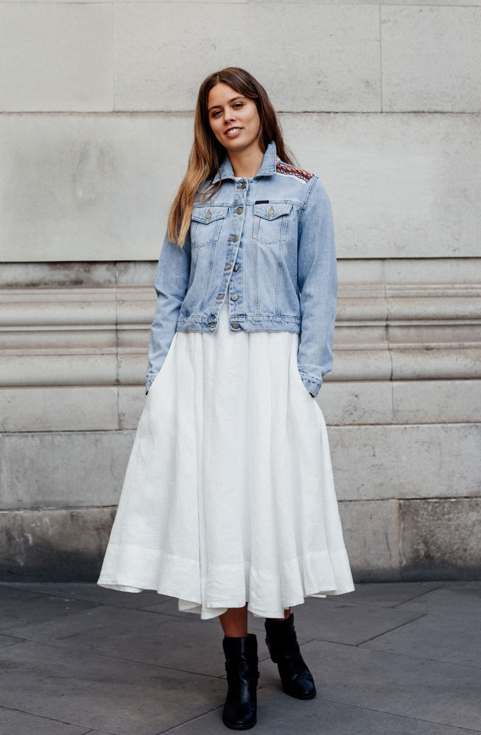 Jil wears white dress with fitted denim jacket