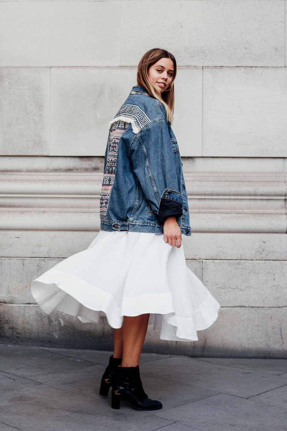 Jil wears white dress with oversized denim jacket