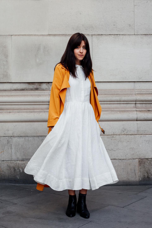 Besma wears white dress with mustard jacket