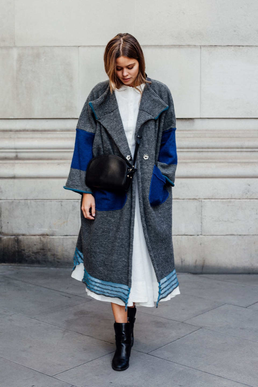 Jil wears white dress with grey coat