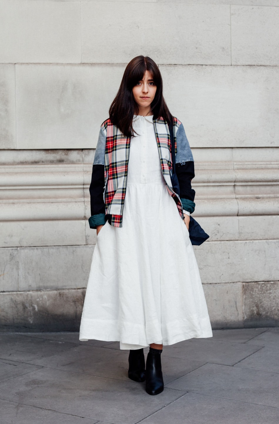 Besma wears white dress with patchwork jacket