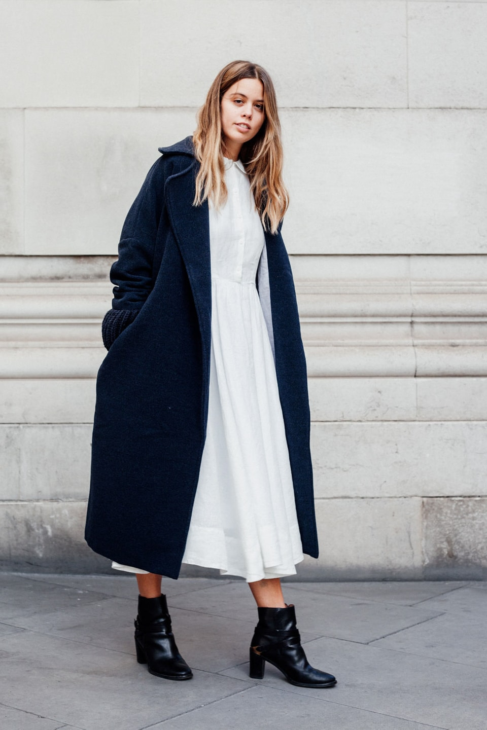 Jil wears white dress with navy coat
