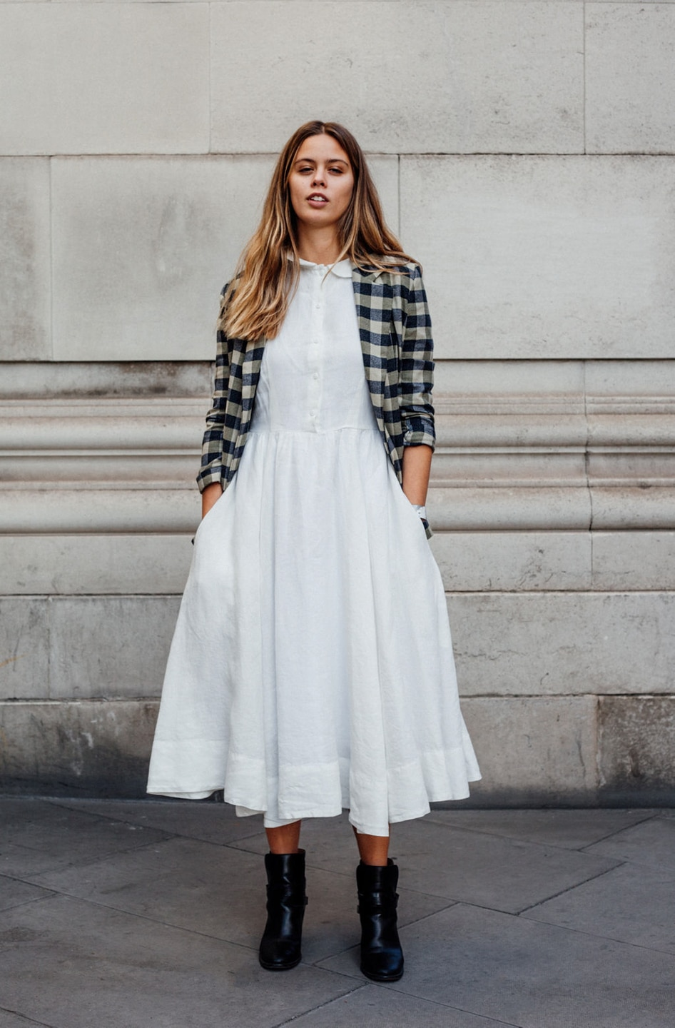 Jil wears white dress with checked jacket