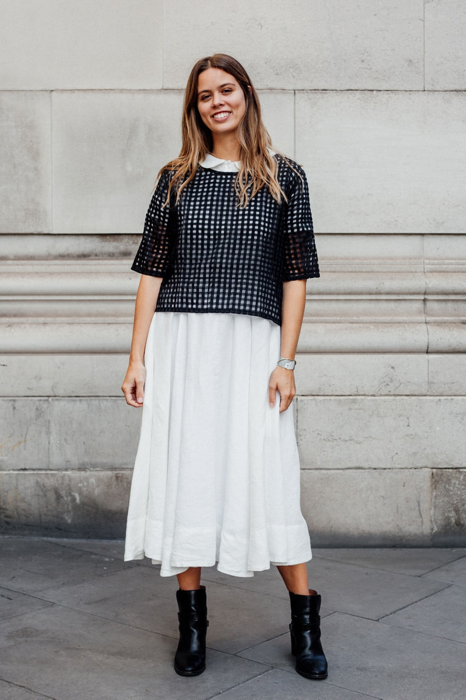 Jil wears white dress with black netted blouse