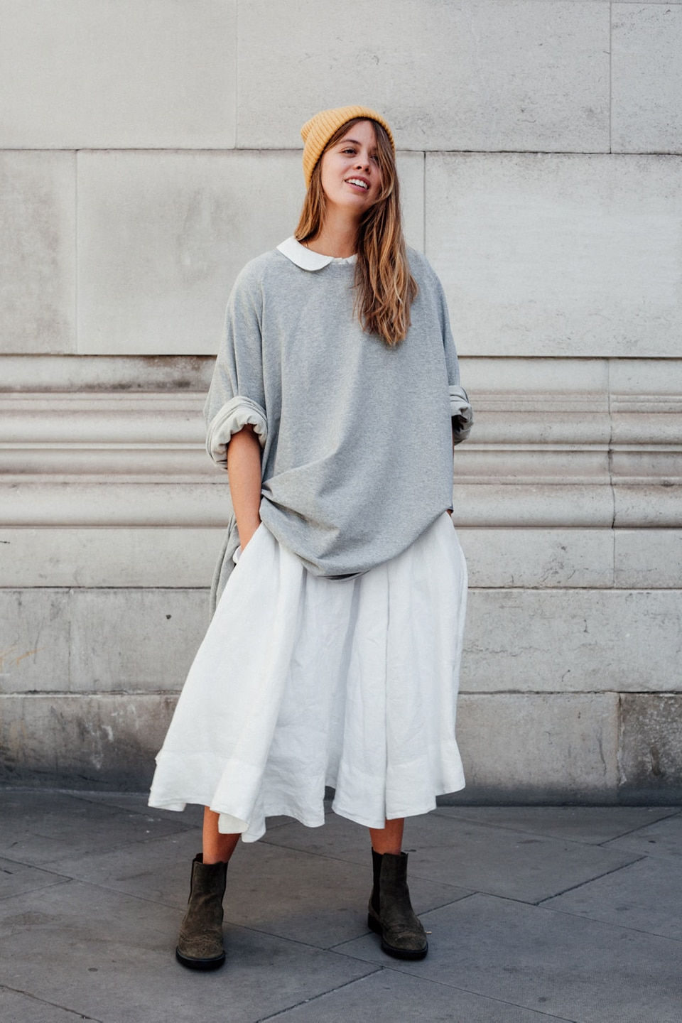 Jil wears white dress with oversized sweater