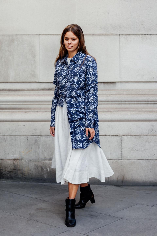 Jil wears white dress with blue multi-length jacket