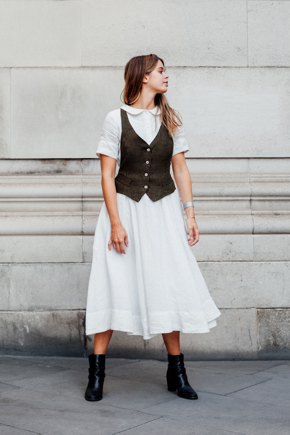 Jil wears white dress with waistcoat