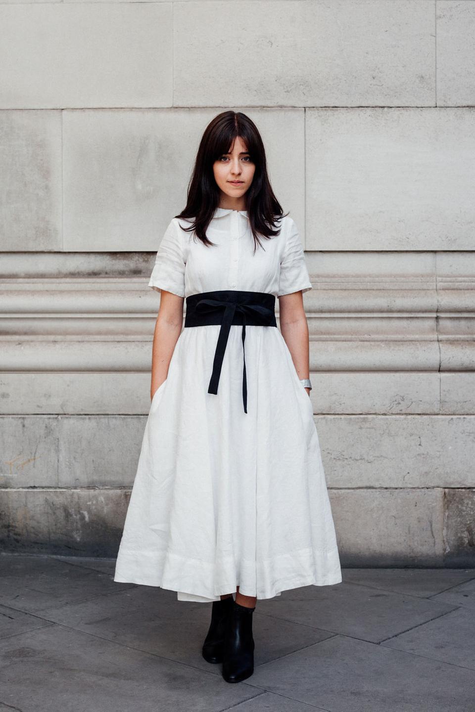 Besma wears white dress with black belt