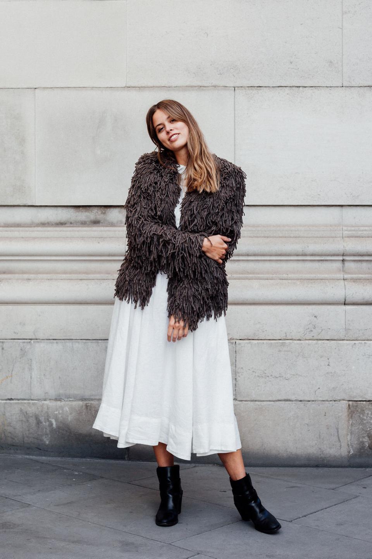 Jil wears white dress with teddy coat