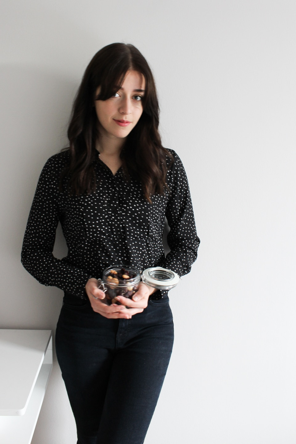 Besma holds Fairtrade Chocolate Caramelised Cashews with Cranberries