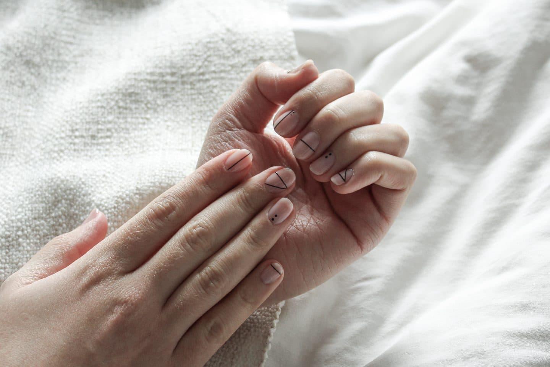 Minimal gel nail art shown across two hands