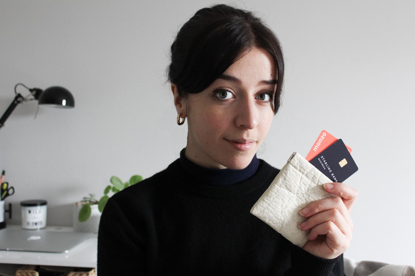 Besma holding pinatex purse with bank cards