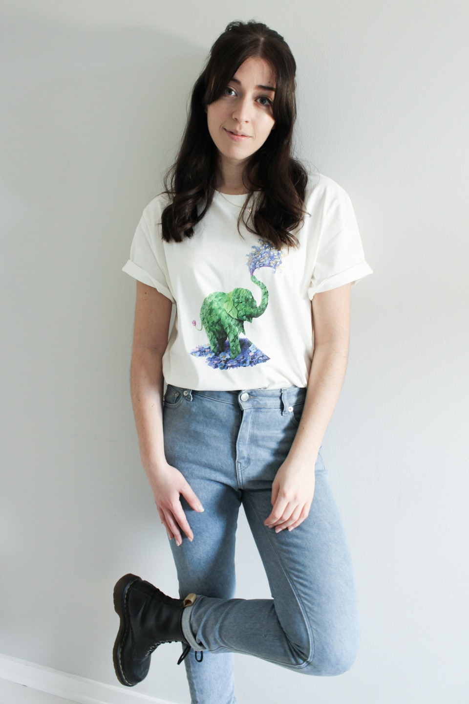 Besma wears Pangaia t-shirt with MUD jeans and vegan leather Dr Martens