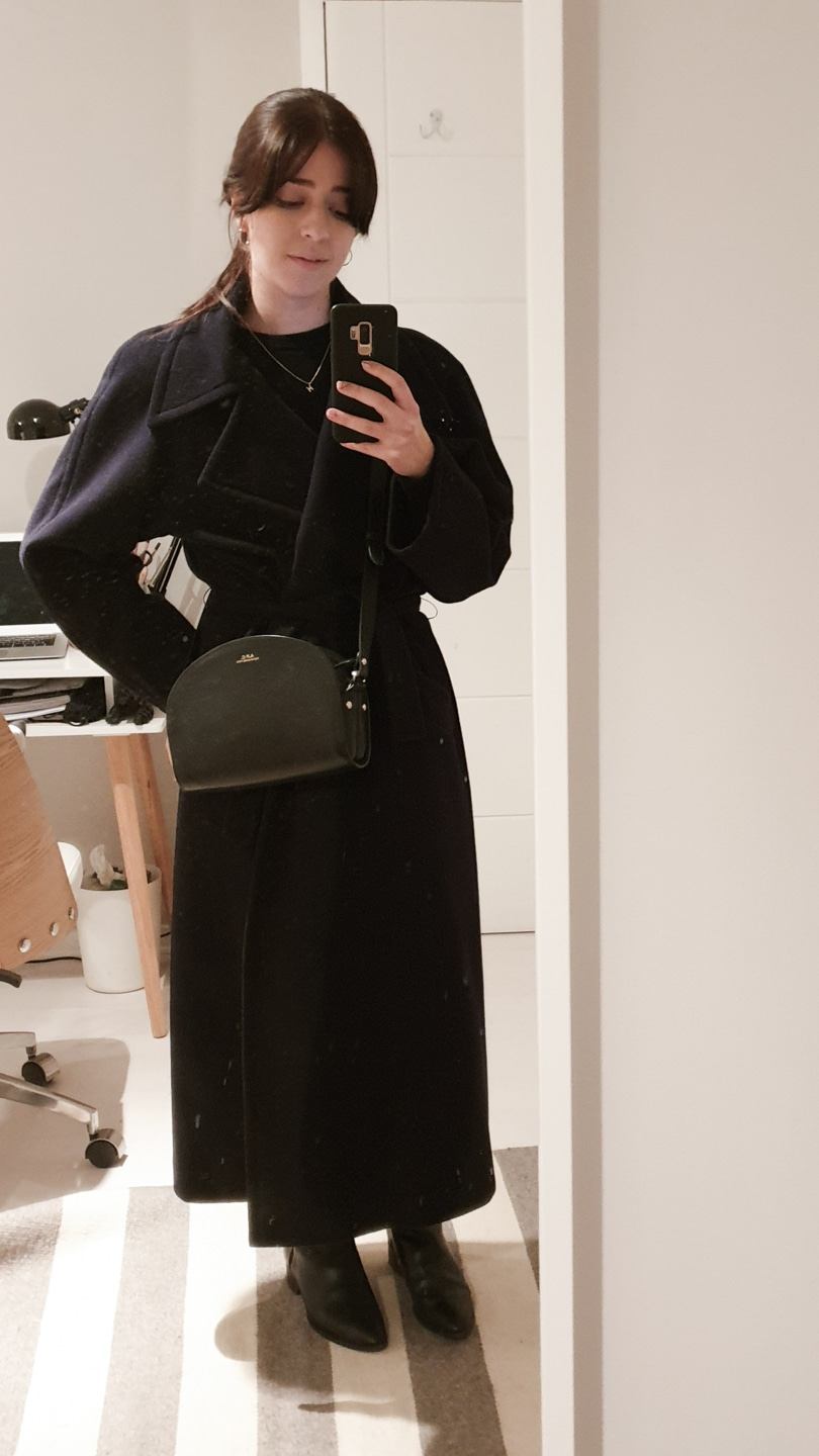 Navy full-length coat and APC bag