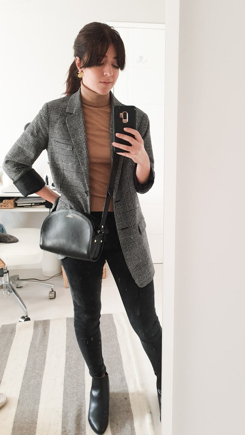 Beige roll-neck jumper with grey blazer, black jeans and black boots