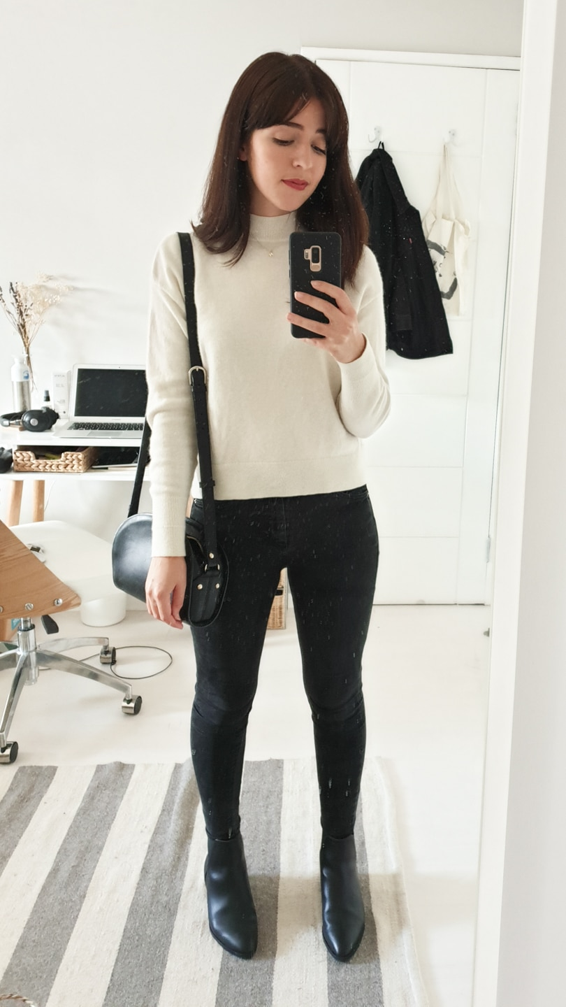 Cream roll-neck jumper with black jeans and boots