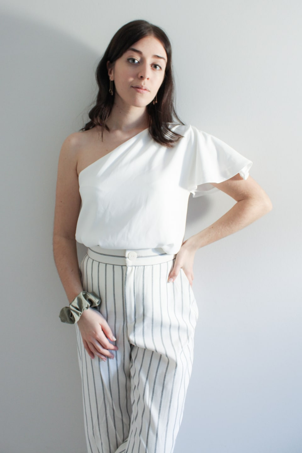 Besma wears sustainable one-shoulder top with second-hand trousers and scrunchie made from fabric waste