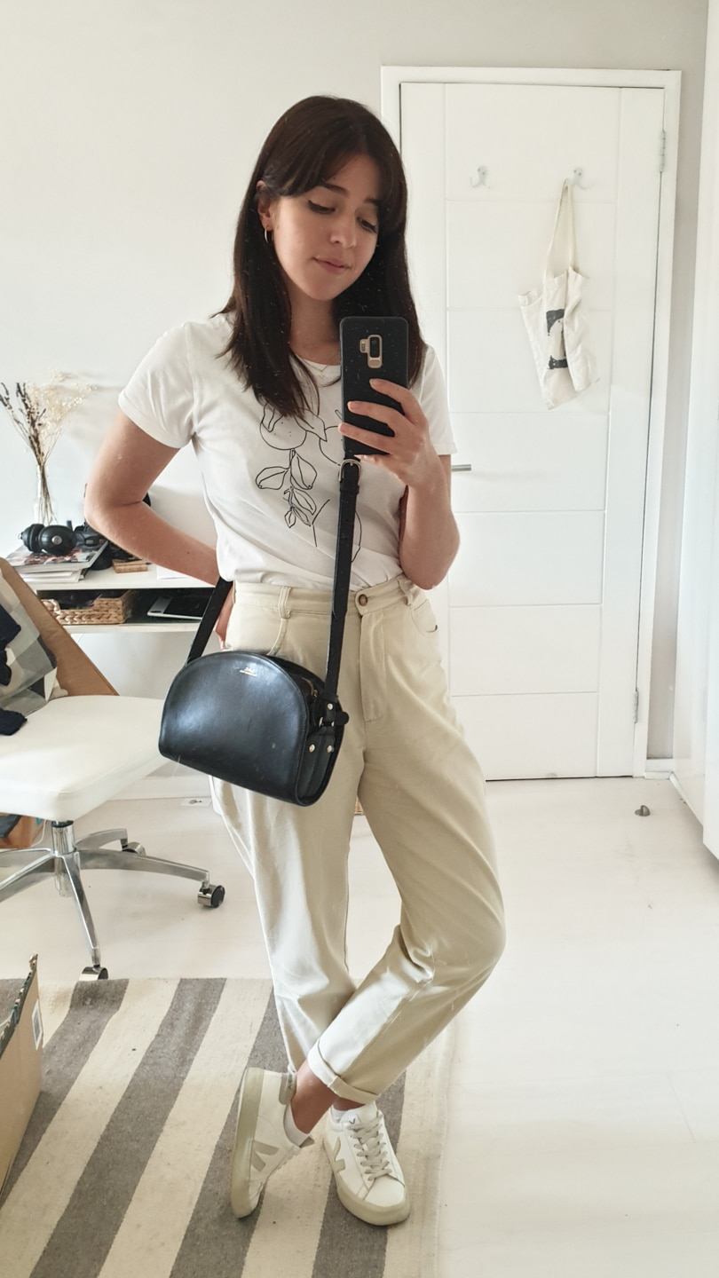 White t-shirt with cream trousers and white sneakers