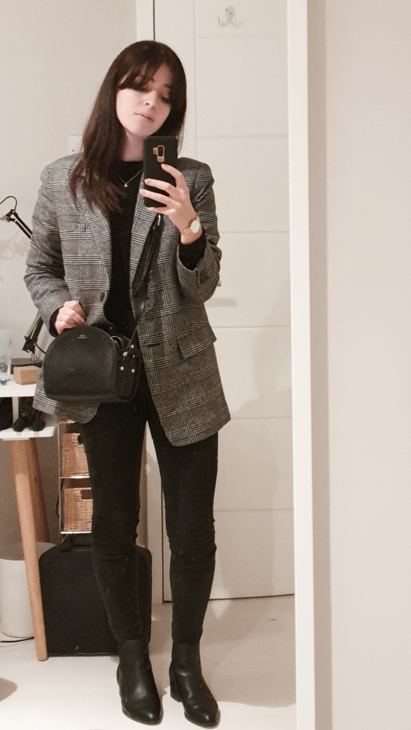 Grey blazer with black t-shirt, black jeans, and black boots