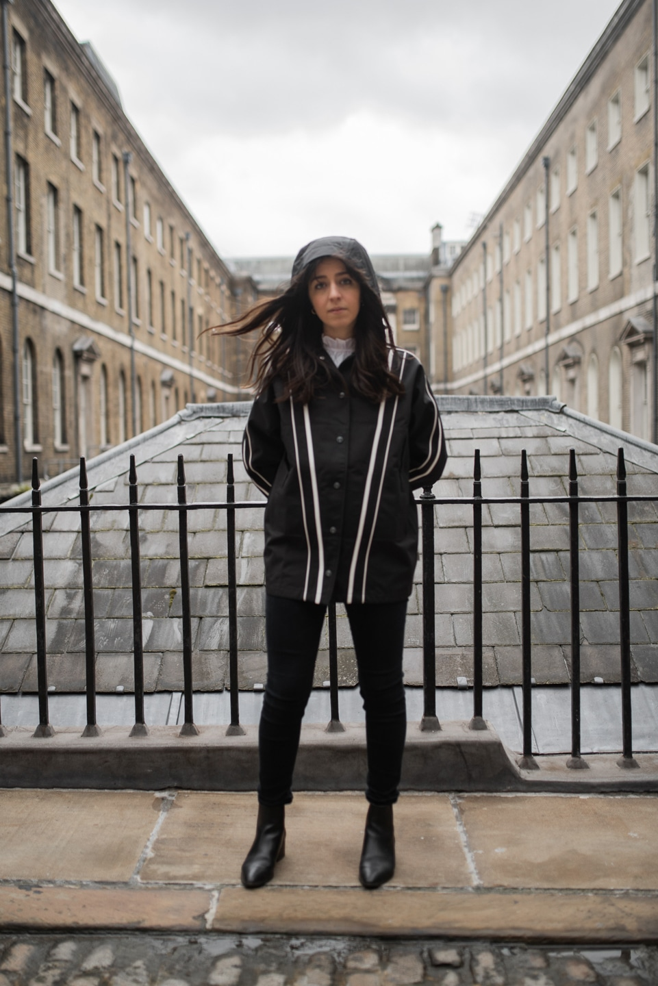 Besma wears sustainable coats from On Good Authority with hood up