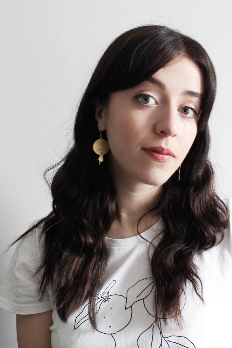 Besma wears Pivot Jewellery earrings and t-shirt from Nude Ethics