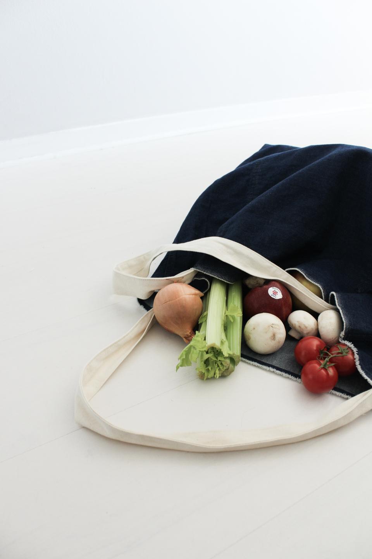 Blue denim tote bag with vegetables inside