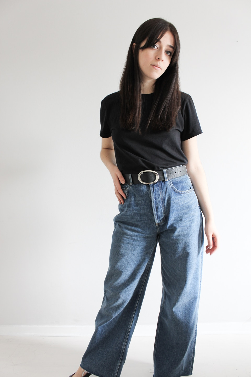 Besma wears black t-shirt and jeans