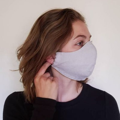 Woman wears grey Cedar and Vine linen mask