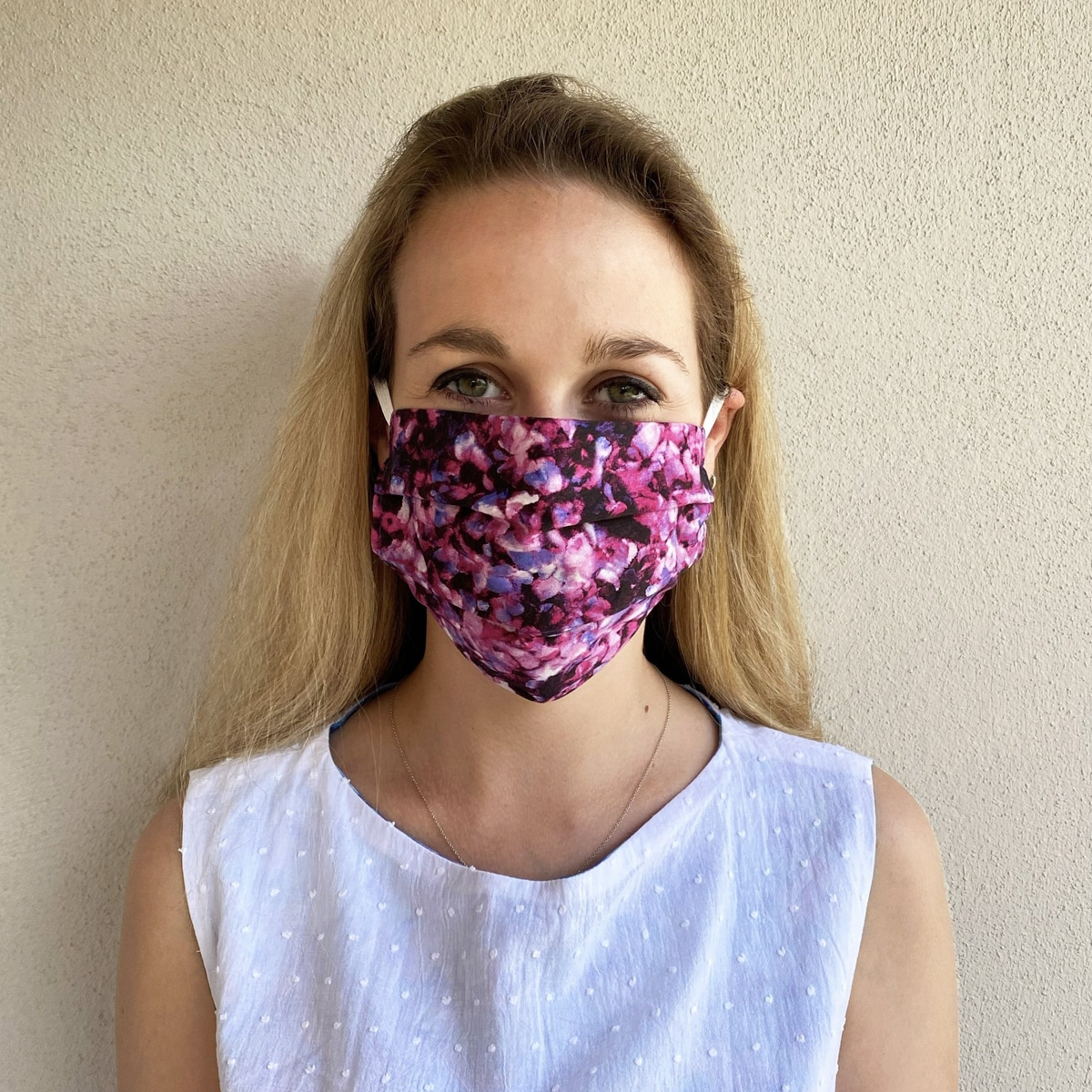 Woman wears floral face covering from Isabel Manns
