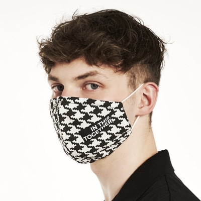 Man wears patterned PHYNE Mask