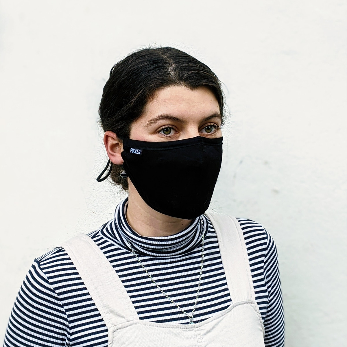 Woman wears black Pucker Mask