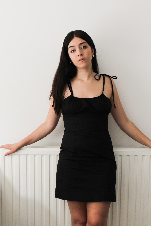 Besma wears black cotton dress from Wearth London