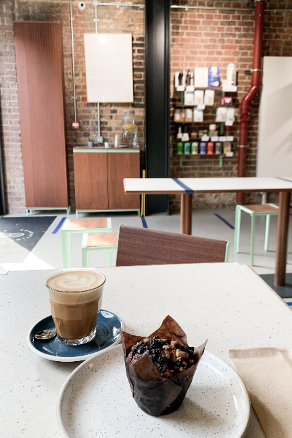 Breakfast muffin and coffee on table at Redemption Roasters