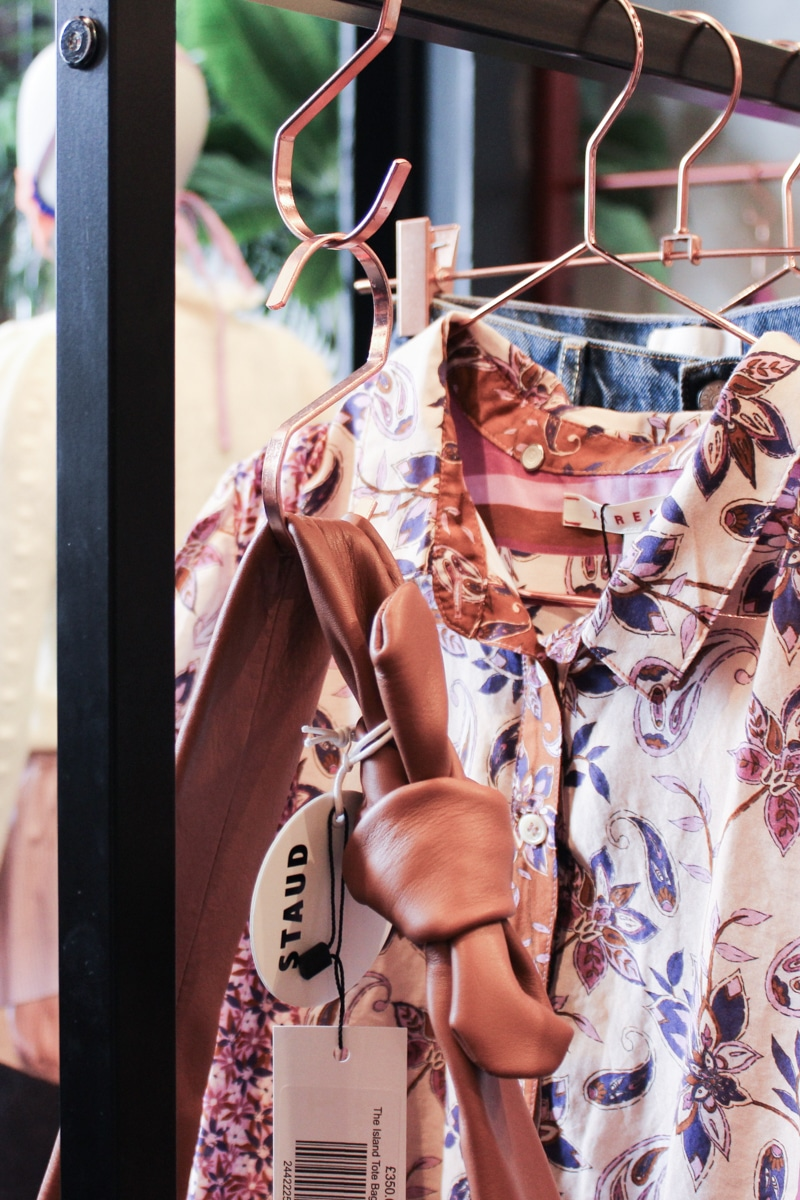 Close-up of Staud Bag and silk shirt at Twiin