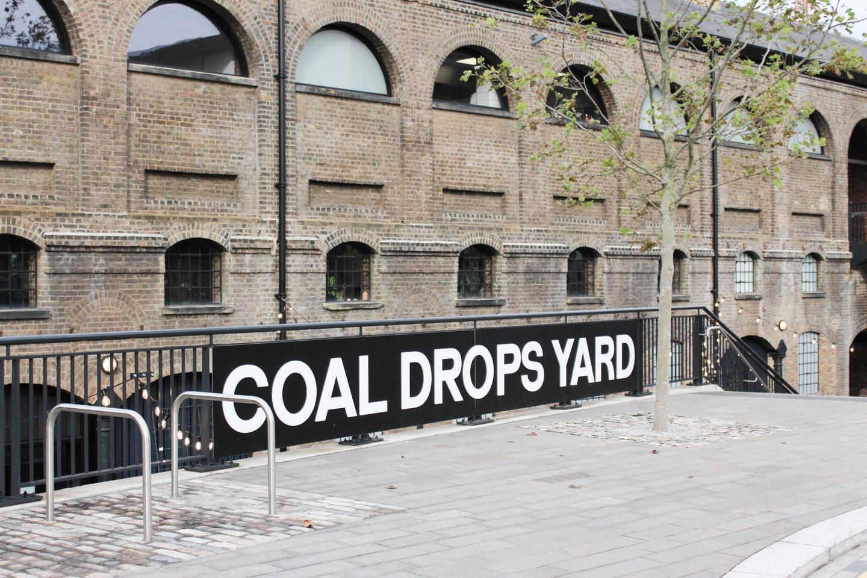 Coal Drops Yard sign against railings