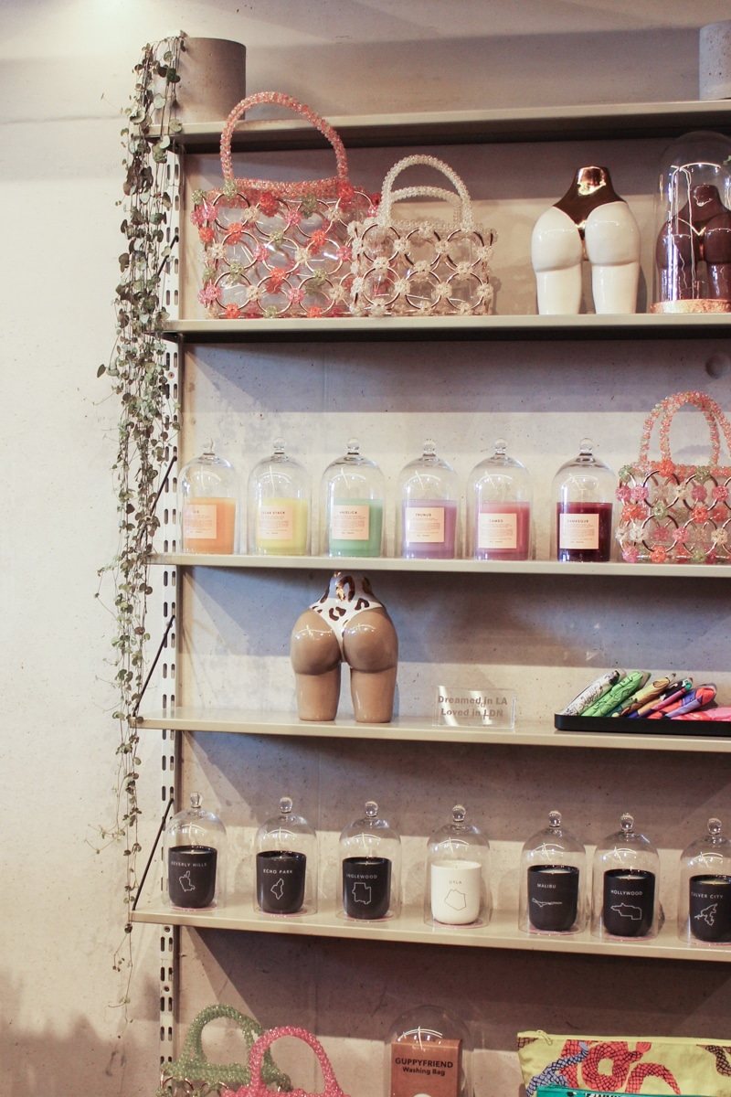 Shelf of candles and booty-shaped vases at Twiin Store