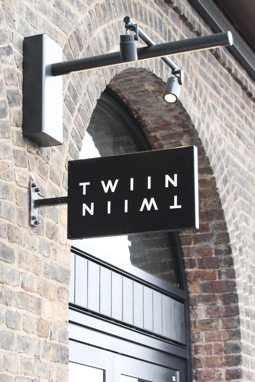 Twiin Store sign