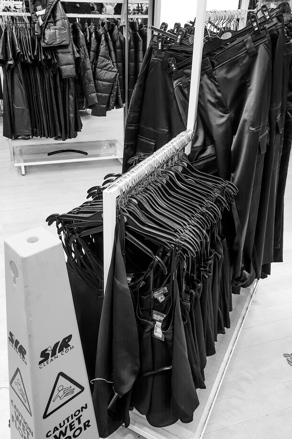 Black clothing pulled from hangers