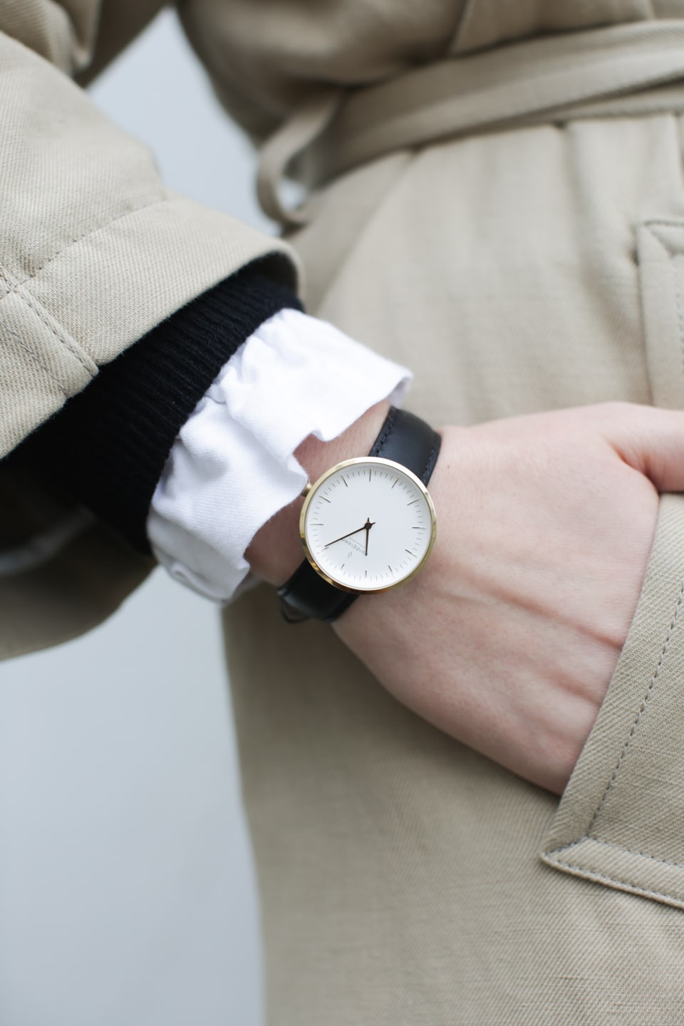 Hand in pocket with watch