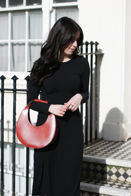 Besma wears long sleeve rib dress with brown circle bag