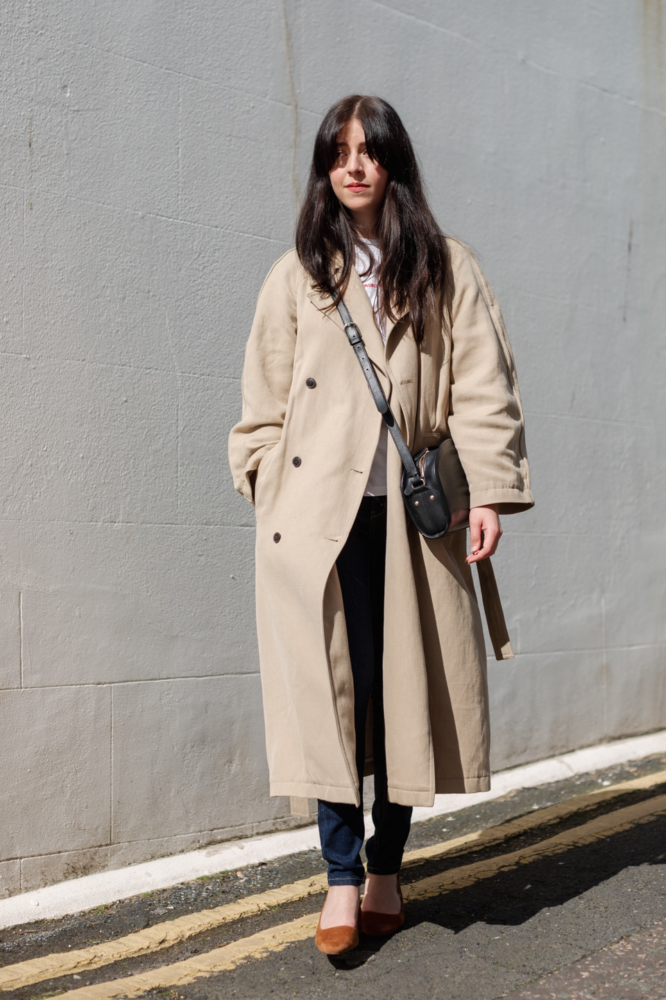 Besma wears circular jeans with second-hand coat, bag, and shoes