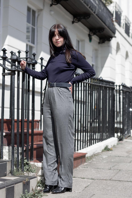 Full-length shot of Besma wearing NinetyPercent roll-neck and EDIS trousers